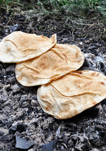 Crispy Pita Bread Cooked on Hot Wood Ash