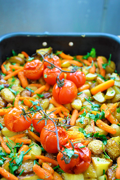 Spring roasted veggies - baby potatoes, baby carrots, cherry tomatoes and greens