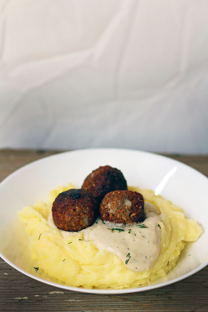 vegan meatballs in white sauce mashed potatoes