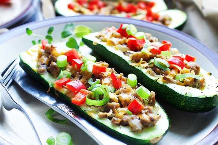 baked vegan Zucchini boats with mushroom stuffing