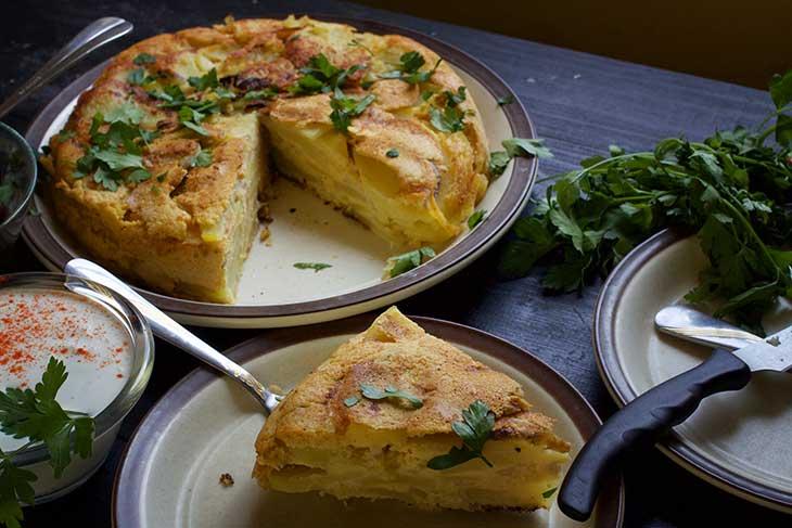 Vegan Potato Tortilla spanish recipe slice on a plate