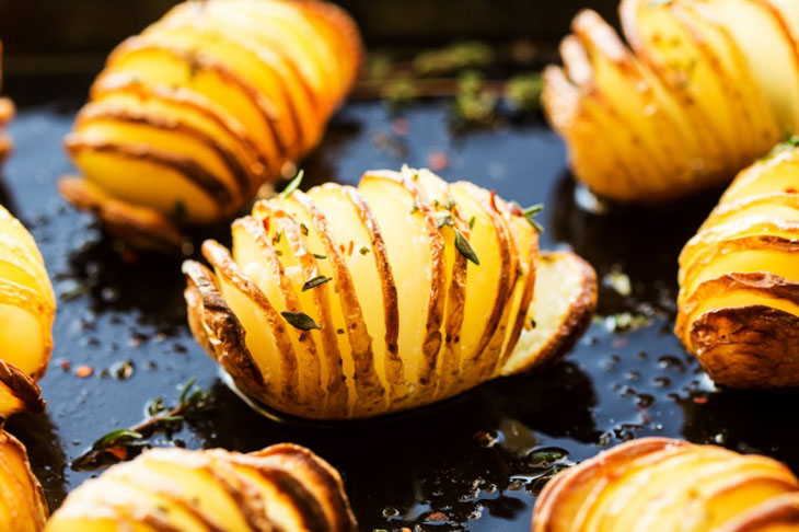 Vegan Hasselback Potatoes in Herby Oil