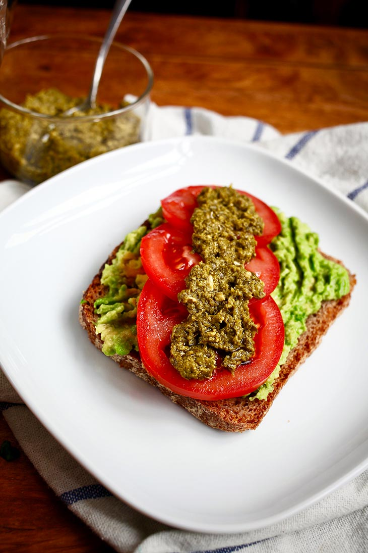 Vegan Smashed Avocado Toast with Basil Pesto and Tomatoes