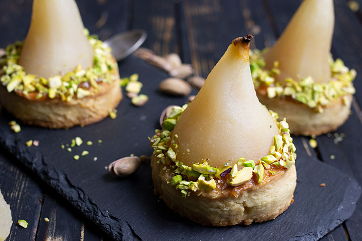 White Wine Poached Pears with Vanilla-Pistachio Blondie Dessert