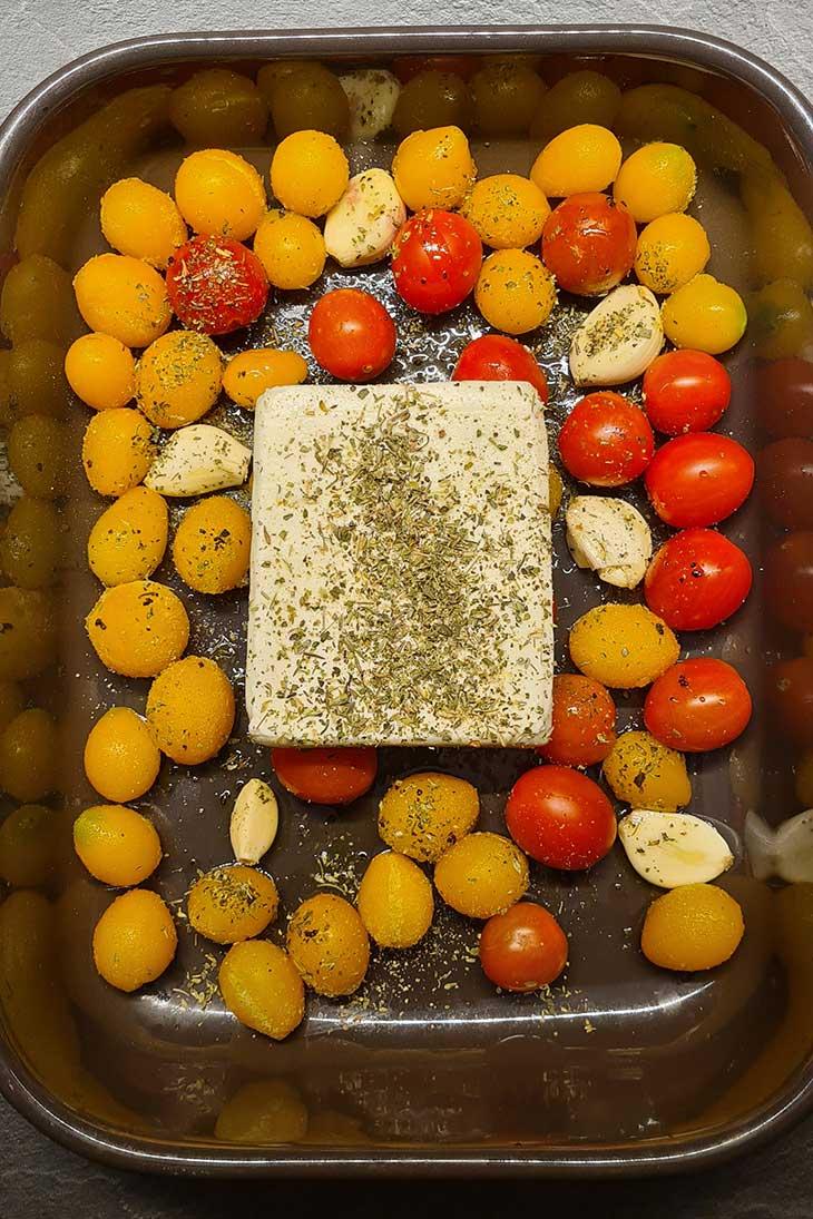 Roasted feta cheese with tomatoes branza feta la cuptor