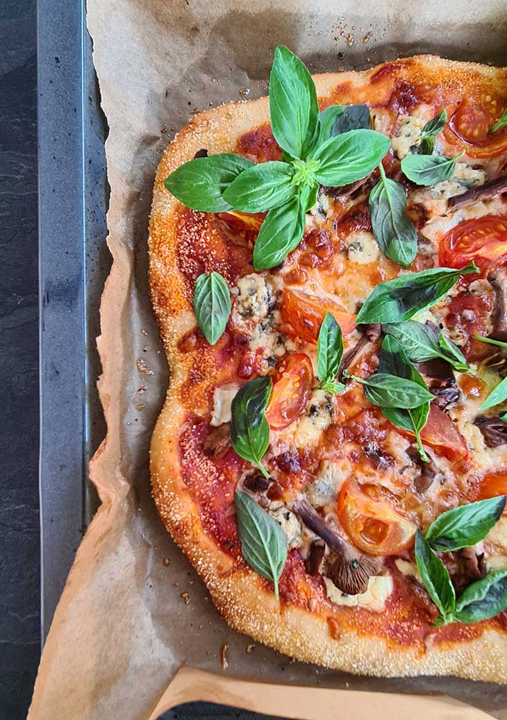 Homemade Pizza with Artichoke and Mushrooms